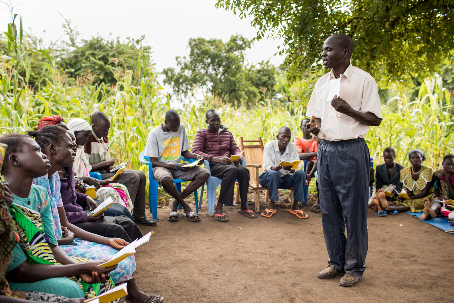SE Field Officer Matthew Aju trains Struggle savings group. Photo by Esther Havens